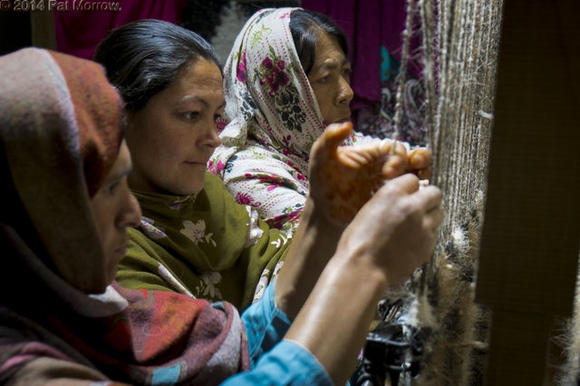 Weavers at Women's cooperative handicraft centre, Misgar village just north of Sost, Hunza Valley, Karakoram Range, Pakistan