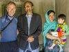 Amran Jan Dario, poet, musician, guide, with family and Bill Hanlon, Zood Khun village, Chipurson Valley, tributary of Hunza Valley, Pakistan
